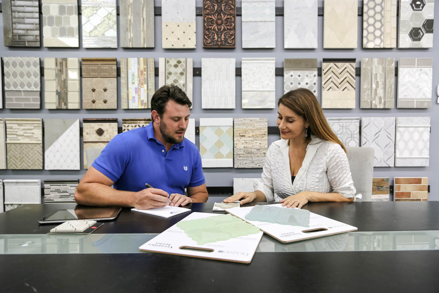 Flooring professional and client reviewing flooring order