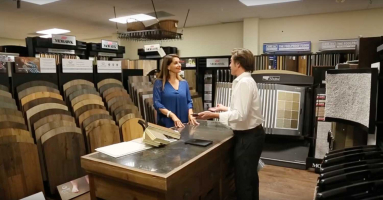 Flooring professional and client discussing flooring order