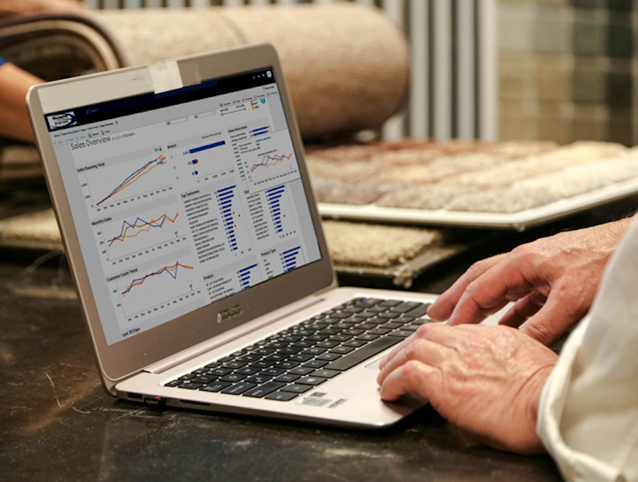 virtual accountant using RollMaster Flooring Software to run reports
